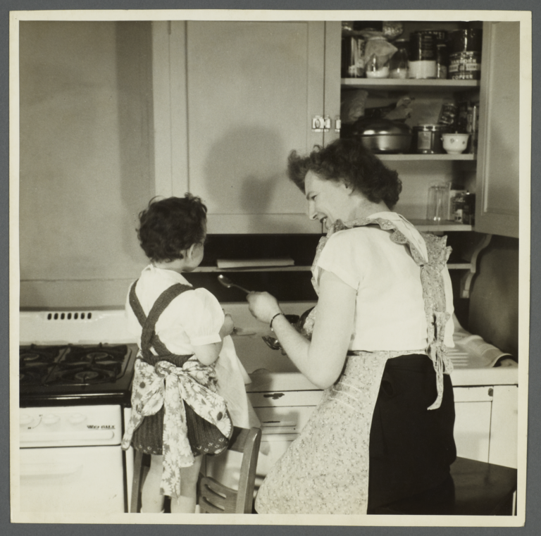 Lenox Hill, 1948-1949 Album -- Woman with Girl in Kitchen