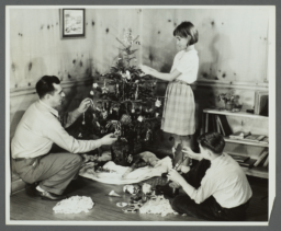 Lenox Hill, 1948-1949 Album -- Decorating Christmas Tree