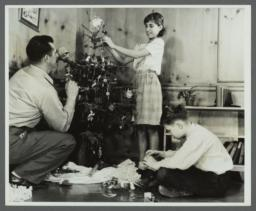 Lenox Hill, 1948-1949 Album -- Placing Ornaments on Christmas Tree