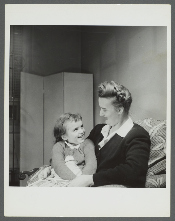 Lenox Hill, 1948-1949 Album -- Woman with Girl Reading Book
