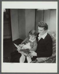 Lenox Hill, 1948-1949 Album -- Reading in Chair