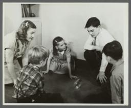 Lenox Hill, 1948-1949 Album -- Woman with Children Playing on Floor