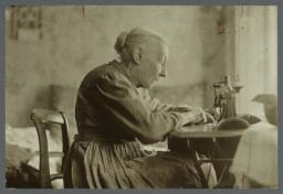 Woman Sewing with Machine