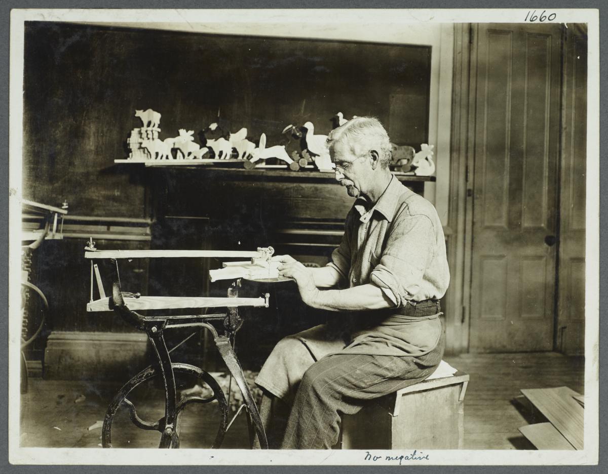 Old Men's Toy Shop Album -- Man Making Wooden Toy