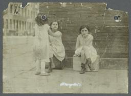 Girl On Box Next to Two Girls