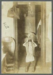 Mulberry Health Center Album -- Little Girl on Scale