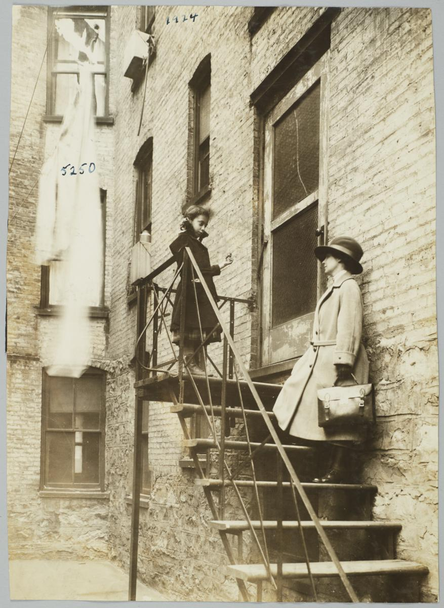Mulberry Health Center Album    Visiting Nurse On Tenement Back Stairs