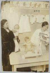 Mulberry Health Center Album -- Nurse, Mother and Two Babies at the Mulberry Health Center